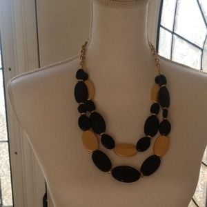 Black and gold wooden bead necklace.
